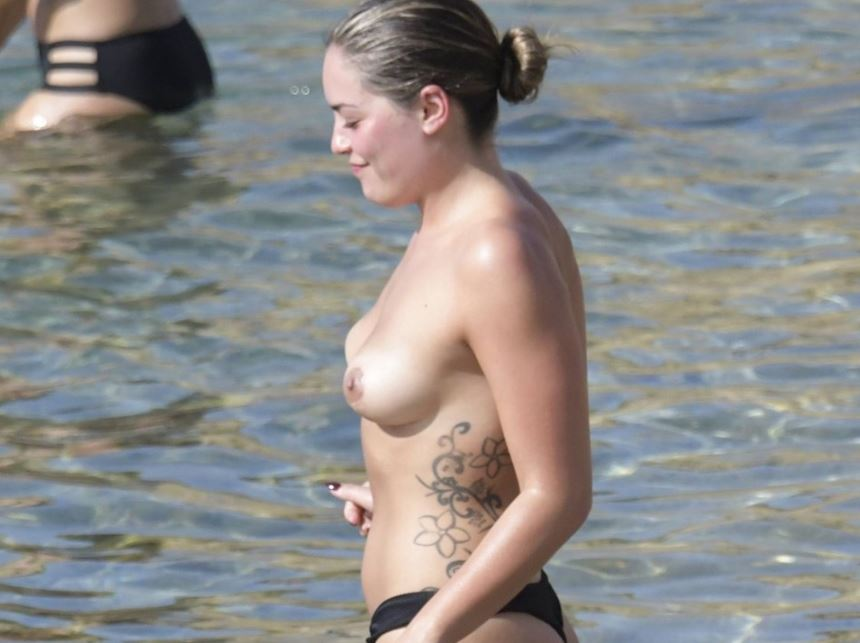 Olympia Valance spotted topless swimming at the beach