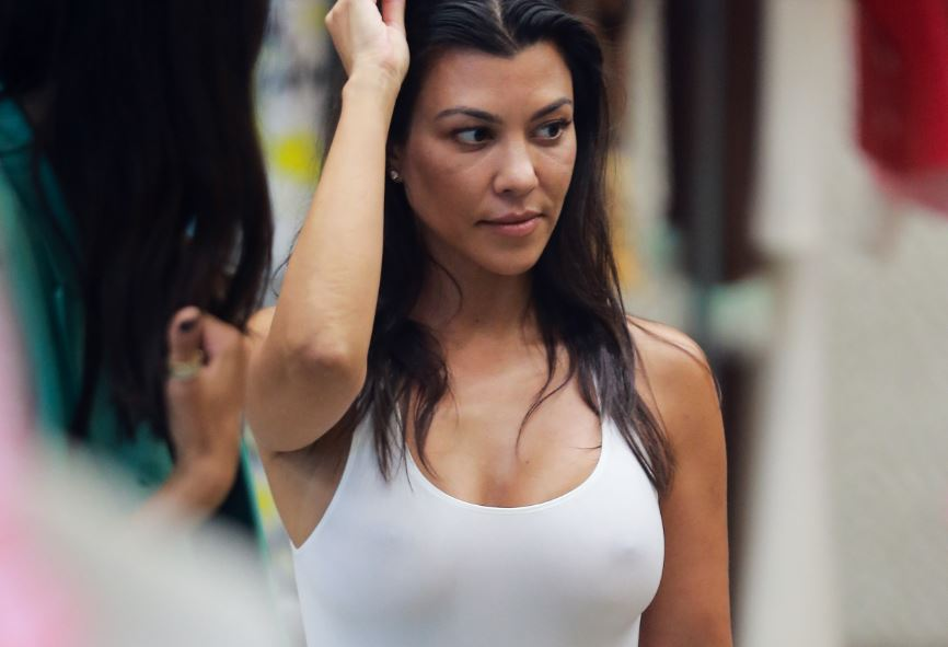 Kourtney Kardashian hard nipples (braless) in white top while shopping